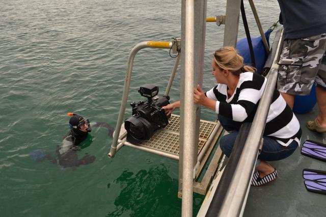 Gemma helps with an underwater camera