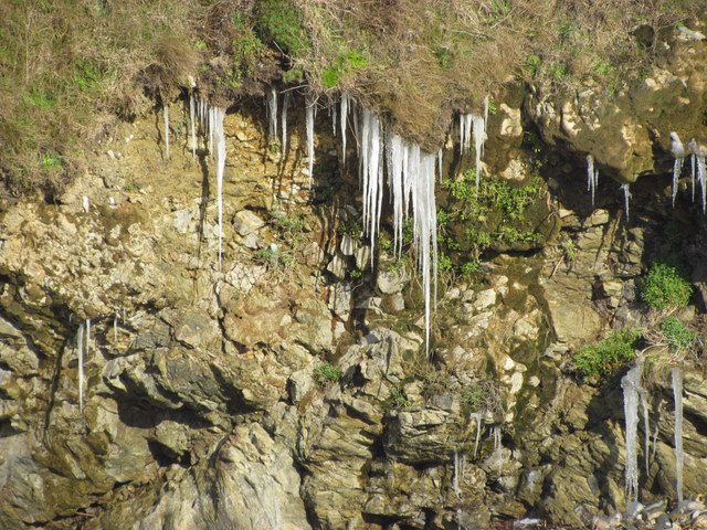 icicles hang form cliffs at the beach