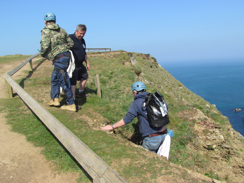 Skipper Chris Lowe and Tim Baine ascend cliff
