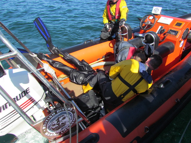 British Divers marine Life Rescue Crew Practise Rescuing casualty from sea alongside Atlantic Diver
