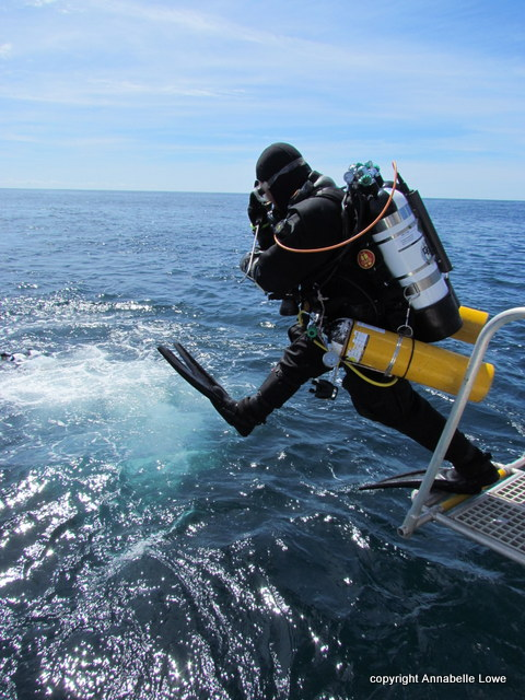 Diver jumps off Diver Recovery Lift from Atlantic Diver